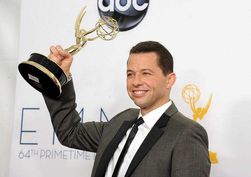 Actor Jon Cryer, winner of Outstanding Lead Actor in a Comedy Series backstage at the 64th Primetime Emmy Awards at the Nokia Theatre on Sunday, Sept. 23, 2012, in Los Angeles. (Photo by Jordan Strauss/Invision/AP)