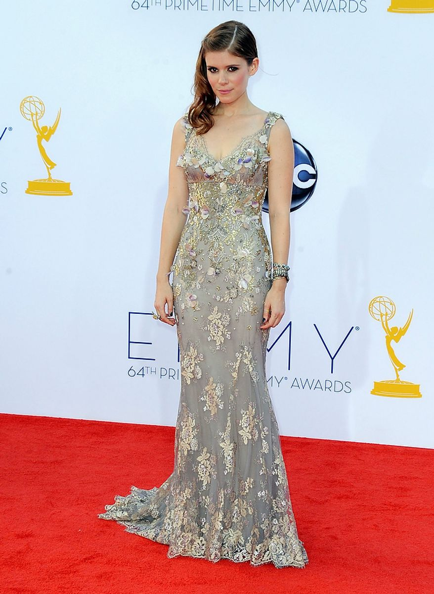 Actress Kate Mara arrives at the 64th Primetime Emmy Awards at the Nokia Theatre on Sunday, Sept. 23, 2012, in Los Angeles.  (Photo by Jordan Strauss/Invision/AP)