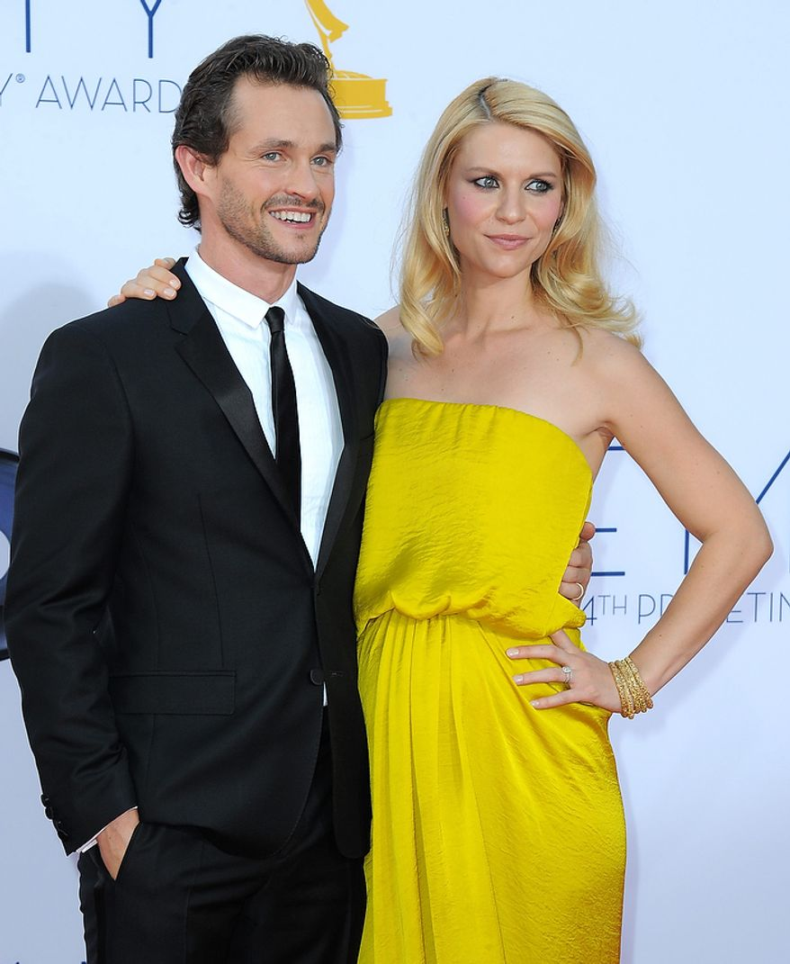 Actress Claire Danes, right and husband Hugh Dancy arrive at the 64th Primetime Emmy Awards at the Nokia Theatre on Sunday, Sept. 23, 2012, in Los Angeles.  (Photo by Jordan Strauss/Invision/AP)