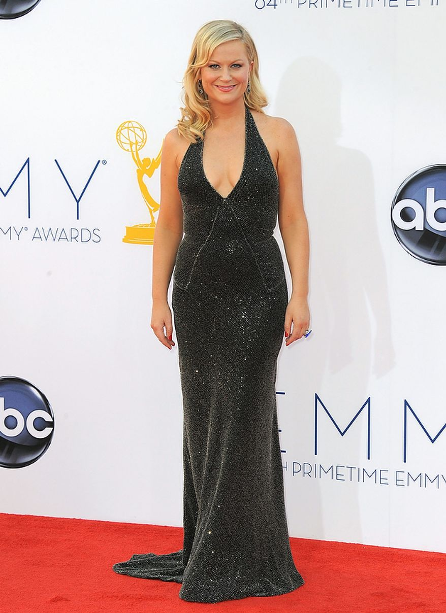 Actress Amy Poehler arrives at the 64th Primetime Emmy Awards at the Nokia Theatre on Sunday, Sept. 23, 2012, in Los Angeles.  (Photo by Jordan Strauss/Invision/AP)