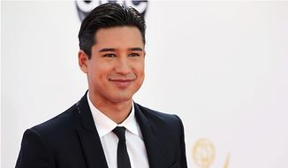 Mario Lopez arrives at the 64th Primetime Emmy Awards at the Nokia Theatre on Sunday, Sept. 23, 2012, in Los Angeles. (Photo by Matt Sayles/Invision/AP)