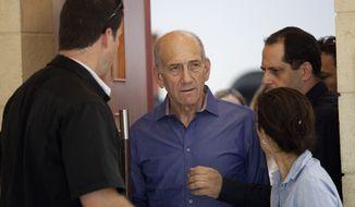 Former Israeli Prime Minister Ehud Olmert (center) leaves Jerusalem's District Court on Monday, Sept. 24, 2012, after being sentenced in a corruption case. (AP Photo/Abir Sultan, Pool)