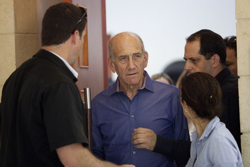Former Israeli Prime Minister Ehud Olmert (center) leaves Jerusalem's District Court on Monday, Sept. 24, 2012, after being sentenced in a corruption case. (AP Photo/Abir Sultan, Pool)