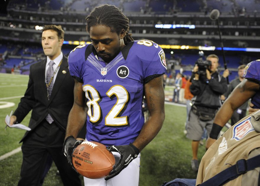 Baltimore Ravens wide receiver Torrey Smith walks off the field after an NFL football game against the New England Patriots in Baltimore, Sunday, Sept. 23, 2012. Baltimore won 31-30. Smith, who was playing less than 24 hours after the death of his 19-year-old brother, had six catches for 127 yards and two touchdowns for the Ravens. (AP Photo/Nick Wass)