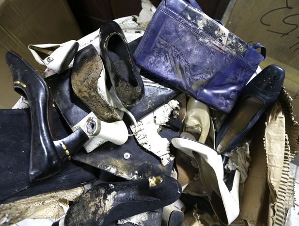 Branded high-heel shoes once worn by flamboyant former Philippine first lady Imelda Marcos sit among equally damaged shoes and bags in a section of the National Museum in Manila on Wednesday, Sept. 19, 2012. (AP Photo/Bullit Marquez)