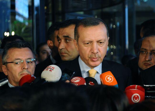 Turkish Prime Minister Recep Tayyip Erdogan speaks to the media in Ankara, Turkey, Friday, Sept. 21, 2012. (AP Photo)