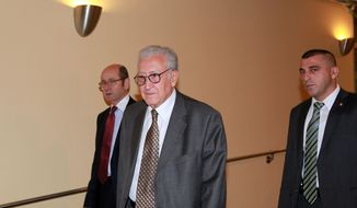 Lakhdar Brahimi (center), the U.N.-Arab League joint special representative for Syria, arrives for closed-door consultations on Syria at the United Nations on Monday, Sept. 24, 2012. (AP Photo/David Karp)