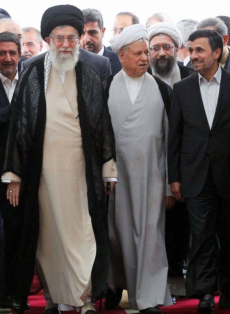 Akbar Hashemi Rafsanjani (center) is flanked by supreme leader Ayatollah Ali Khamenei (left), chief of the Expediency Council, and Iran President Mahmoud Ahmadinejad. Mr. Rafsanjani, who previously served as president of Iran and remains a political force, favors a more moderate approach to the West. (Associated Press)