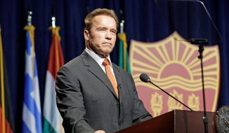 Movie star and former California Gov. Arnold Schwarzenegger delivers the keynote address Monday at a symposium launching the Schwarzenegger Institute for State and Global Policy at the University of Southern California in Los Angeles. (Associated Press)