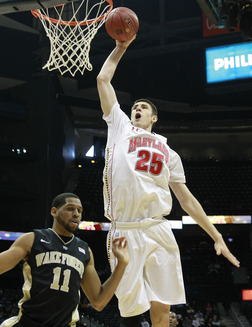 Maryland center Alex Len (25) goes to the basket as Wake Forest guard C.J. Harris (11) looks on in the first half of an NCAA college basketball game first round game at the Atlantic Coast Conference tournament, Thursday, March 8, 2012, in Atlanta. (AP Photo/John Bazemore)