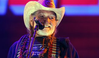 Country music star Willie Nelson performs during the Farm Aid 2012 concert at Hersheypark Stadium in Hershey, Pa., on Saturday, Sept. 22, 2012. (AP Photo/Jacqueline Larma)