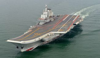 The Chinese aircraft carrier Liaoning takes a test cruise in May 2012. China formally entered the vessel, its first aircraft carrier, into service on Tuesday, Sept. 25, 2012, underscoring the nation's ambitions to be a leading Asian naval power, although the ship is not expected to carry a full complement of planes or be ready for combat for some time. (AP Photo/Xinhua News Agency, Li Tang)