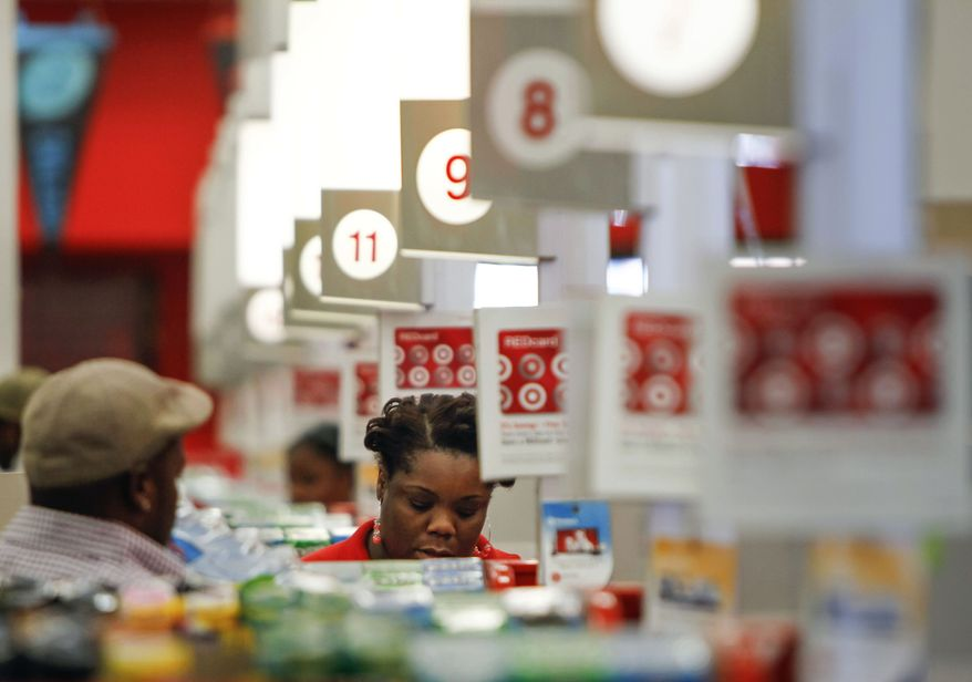 A cashier rings up a sale at a Target store in Chicago on Wednesday, Aug. 22, 2012. (AP Photo/Sitthixay Ditthavong)