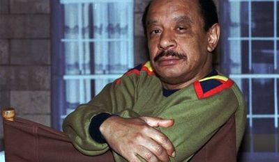 "** FILE ** Actor Sherman Hemsley poses for a photo in Los Angeles in 1986. Mr. Hemsley, who made the irascible, bigoted George Jefferson of ""The Jeffersons"" one of television's most memorable characters and a symbol for urban upward mobility, was found dead on Tuesday, July 24, 2012, at his El Paso, Texas, home. He was 74. (AP photo/Nick Ut)"