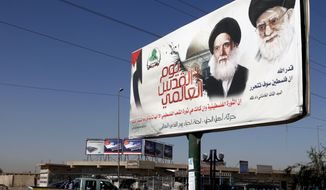A poster depicting Iran's supreme leader, Grand Ayatollah Ali Khamenei (right), and Ayatollah Mohammed Sadiq al-Sadr, late father of the radical anti-U.S. cleric Muqtada al-Sadr, towers over a Baghdad street on Sunday, Sept. 16, 2012. (AP Photo/Karim Kadim)