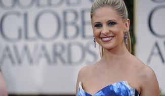 Actress Sarah Michelle Gellar arrives at the 69th annual Golden Globe Awards in Los Angeles on Sunday, Jan. 15, 2012. (AP Photo/Chris Pizzello)