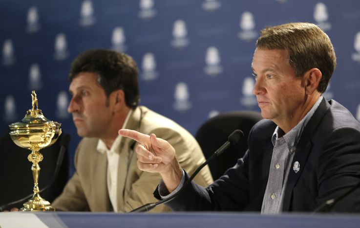 USA's captain Davis Love III, right, and European team captain Jose Maria Olazabal answer questions during a news conference at the Ryder Cup PGA golf tournament Monday, Sept. 24, 2012, at the Medinah Country Club in Medinah, Ill. (AP Photo/David J. Phillip)