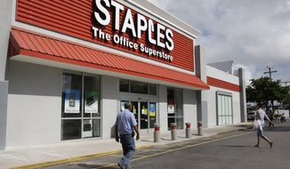A Staples office supply store in Miami is pictured in November 2011. (AP Photo/Lynne Sladky)