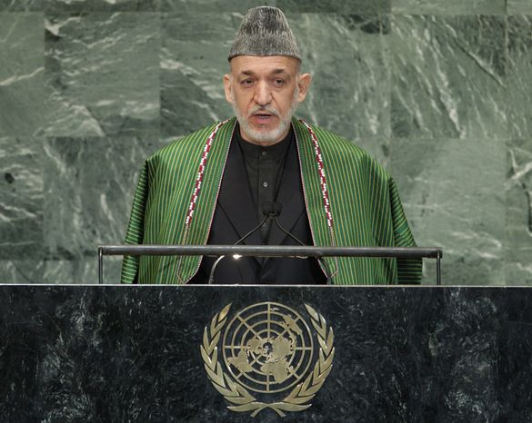 Afghan President Hamid Karzai addresses the 67th session of the United Nations General Assembly at U.N. headquarters Tuesday, Sept. 25, 2012. (AP Photo/Frank Franklin II)