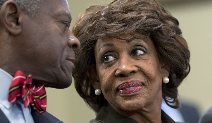 Rep. Maxine Waters, California Democrat, smiles Sept. 21, 2012, at her husband, Sidney Williams (left), during a House Ethics Committee hearing on Capitol Hill in Washington after learning she had been cleared of allegations that she steered a $12 million federal bailout to a bank where her husband owns stock. (Associated Press)