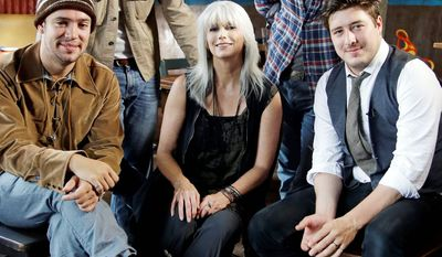 """Emmylou Harris and Mumford & Sons (from left) Ben Lovett, Winston Marshall, Ted Dwane and Marcus Mumford share their love of singing and the banjo Thursday on """"CMT Crossroads."""" (Associated Press)"""