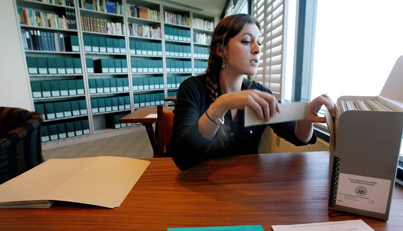 Ernest Hemingway collection intern Jessica Green prepares papers to be sent out for restoration. Among them are letters written to Hemingway from actresses Ingrid Bergman and Marlene Dietrich, and writers F. Scott Fitzgerald and Gertrude Stein. (Associated Press)