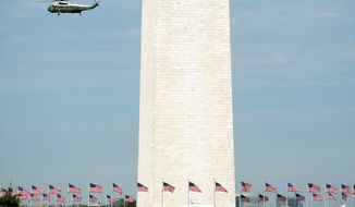 Marine One, the presidential helicopter, could complicate repairs to the Washington Monument during flyovers as a result of White House security measures, the National Park Service says. (Andrew Harnik/The Washington Times)