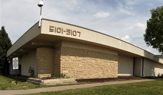 ** FILE ** This June 1, 2009, photo shows the clinic in Wichita, Kan., that was owned by Dr. George Tiller. The shuttered abortion clinic has been bought by an abortion-rights group that intends to reopen it as a family and women's health center that will offer abortions, among other services. (AP Photo/Charlie Riedel, File)