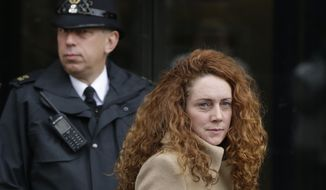 **FILE** Rebekah Brooks, the former chief of News Corp.'s British operations, leaves the Old Bailey court in London on Sept. 26, 2012. (Associated Press)