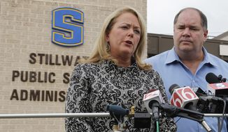 Ann Caine, superintendent of Stillwater schools, answers a question during a news conference in Stillwater, Okla., on Wednesday, Sept. 26, 2012, after a 13-year-old student shot and killed himself in a hallway at an city junior high school before classes began Wednesday. Looking on is Stillwater police Capt. Randy Dickerson. (AP Photo/Sue Ogrocki)