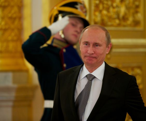 **FILE** Russian President Vladimir Putin walks prior to a Sept. 26, 2012, ceremony of receiving credentials in Moscow's Kremlin. (Associated Press)