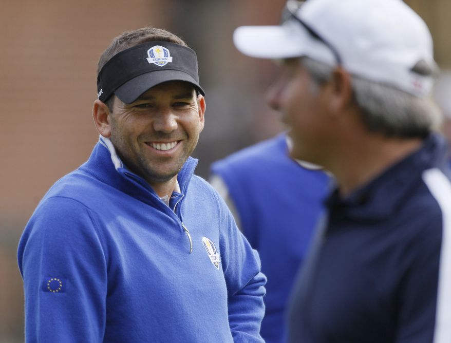 Europe's Sergio Garcia talks to Fred Couples at the Ryder Cup PGA golf tournament Wednesday, Sept. 26, 2012, at the Medinah Country Club in Medinah, Ill. (AP Photo/Charles Rex Arbogast)