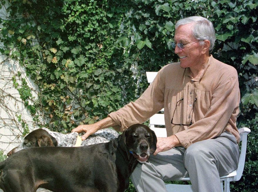 **FILE** Andy Williams spends time with his dogs at his theater in Branson, Mo., on Aug. 25, 2000. (Associated Press)