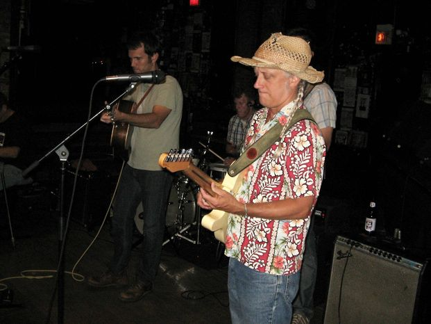 Electric guitarist Steve Doyle, right, and lead singer/guitarist Trevor McSpadden perform during Honky Tonk Happy Hour at the Empty Bottle tavern in Chicago. (Associated Press)