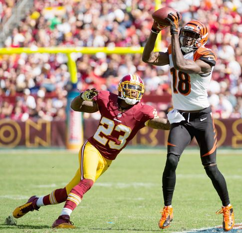 Redskins defensive backs seemed to be a step off Sunday as Cincinnati passed for 385 yards. Cornerback DeAngelo Hall arrived too late to prevent this completion to Bengals wide receiver A.J. Green. (Andrew Harnik/The Washington Times)