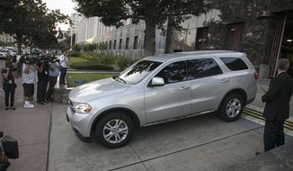 U.S. Federal marshals drive away in a vehicle believed to be carrying Nakoula Basseley Nakoula after his arraignment in federal court in Los Angeles Thursday, Sept. 27, 2012. A federal judge ordered Nakoula, the man behind a crudely produced anti-Islamic video that inflamed parts of the Middle East, to be detained because he is a flight risk and for violating terms of his probation. (Associated Press)