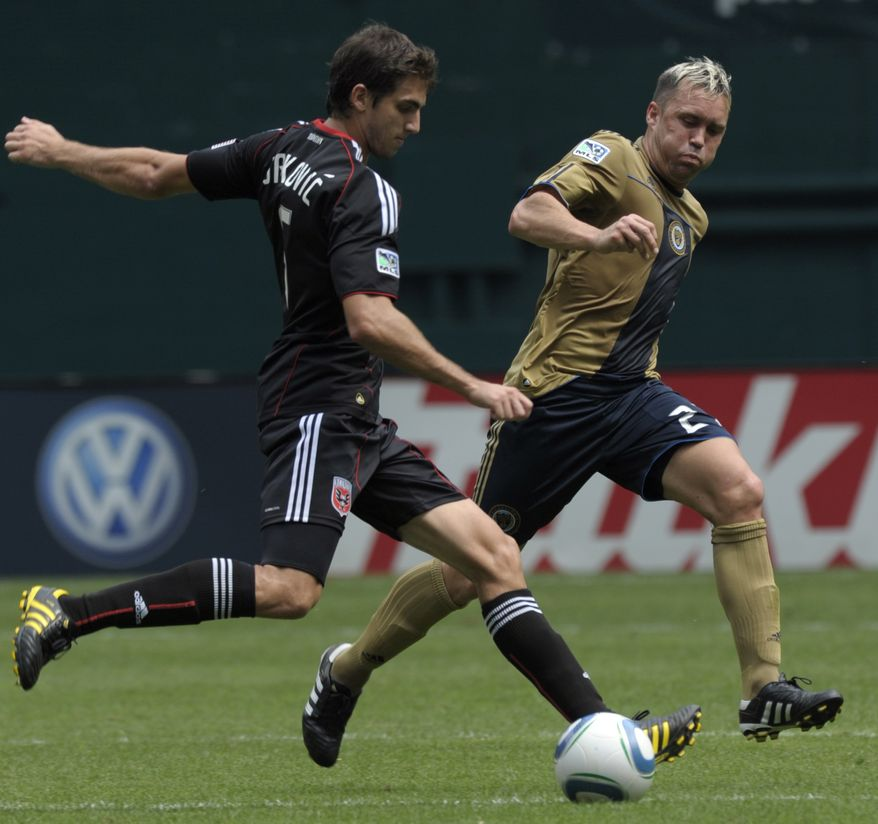 D.C. United defender Dejan Jakovic, left, battles for the ball with Philadelphia Union midfielder Eduardo Coudet, right, during the first half of their MLS soccer game at RFK Stadium in Washington, Sunday, Aug. 22, 2010. DC United defeated the Union 2-0. (AP Photo/Susan Walsh)