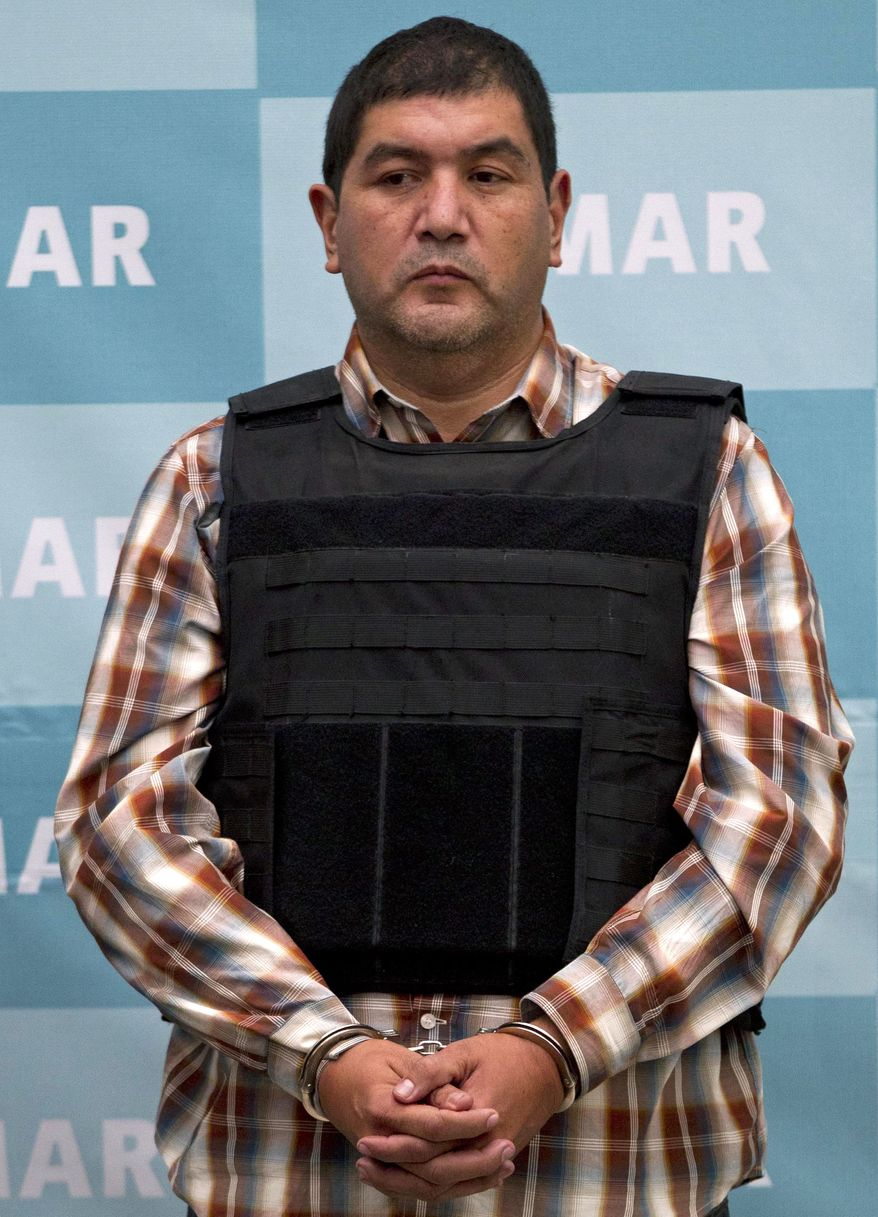 """Ivan Velazquez Caballero, the alleged leader of a faction of the hyperviolent Zetas drug cartel who is known as """"El Taliban,"""" is shown during a media presentation at the Mexican navy's Center for Advanced Naval Studies in Mexico City on Thursday, Sept. 27, 2012. (AP Photo/Eduardo Verdugo)"""