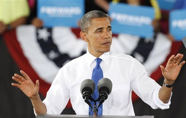 President Barack Obama gestures during a rally in Virginia Beach, Va., Thursday, Sept. 27, 2012. (AP Photo/Steve Helber)