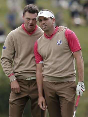 Europe's Martin Kaymer, left, talks to Sergio Garcia during a practice round at the Ryder Cup PGA golf tournament Thursday, Sept. 27, 2012, at the Medinah Country Club in Medinah, Ill. (AP Photo/Charlie Riedel)