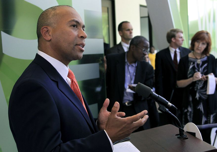Massachusetts Gov. Deval Patrick speaks with reporters in Cambridge, Mass., on Thursday, Sept. 27, 2012. Mr. Patrick said he expects criminal charges will be brought in an investigation of misconduct by a state lab chemist who admitted faking drug-sample results, forging signatures and skipping proper procedures. (AP Photo/Steven Senne)