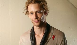 """** FILE ** This Sept. 14, 2011, file photo shows actor Johnny Lewis posing for a portrait during the 36th Toronto International Film Festival in Toronto, Canada. Authorities say Lewis fell to his death after killing an elderly Los Angeles woman. Lewis appeared in the FX television show """"Sons of Anarchy,"""" for two seasons. The woman killed is identified as 81-year-old Catherine Davis. (AP Photo/Carlo Allegri, file)"""