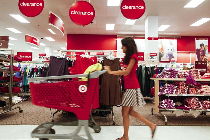 **FILE** A shopper pushes a cart Aug. 22, 2012, through the clearance section of a Target store in Chicago. ((Associated Press)