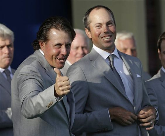 USA's Matt Kuchar, right, watches as Phil Mickelson is introduced during the opening ceremony at the Ryder Cup PGA golf tournament Thursday, Sept. 27, 2012, at the Medinah Country Club in Medinah, Ill. (AP Photo/Chris Carlson)
