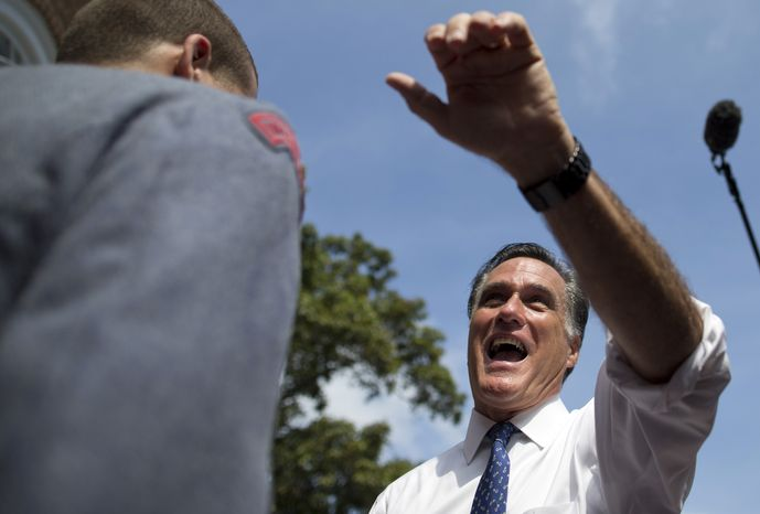 Republican presidential candidate Mitt Romney shakes hands during a Sept. 28, 2012, rally at Valley Forge Military Academy and College in Wayne, Pa. (Associated Press)