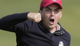 USA's Keegan Bradley celebrates Sept. 28, 2012, after winning their foursomes match on the 15th hole at the Ryder Cup PGA golf tournament at the Medinah Country Club in Medinah, Ill. (Associated Press)