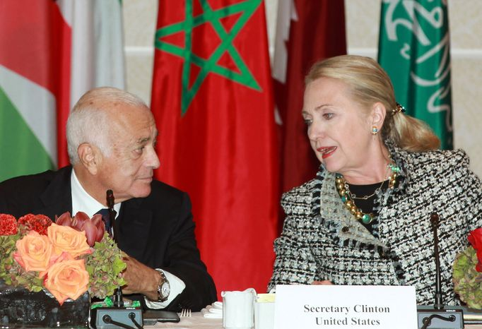 Secretary of State Hillary Rodham Clinton (right) welcomes Nabil Elaraby (left), Head of the Arab League, during a Clinton-hosted gathering of Friends of Syria group on Sept. 28, 2012, in New York. (Associated Press)