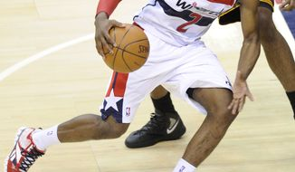 **FILE** Washington Wizards guard John Wall (2) drives to the basket April 14, 2012, against the Cleveland Cavaliers during the second half of the Cavaliers' 98-89 victory in Washington. (Associated Press)