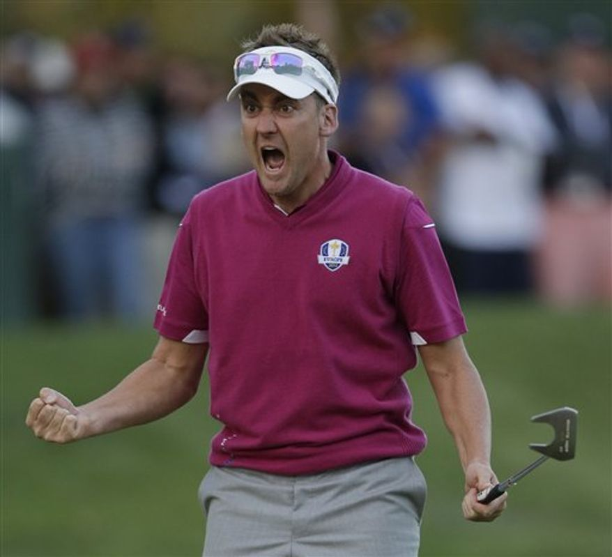 Europe's Ian Poulter reacts after making a putt on the 16th hole during a four-ball match at the Ryder Cup PGA golf tournament Saturday, Sept. 29, 2012, at the Medinah Country Club in Medinah, Ill. (AP Photo/Chris Carlson)