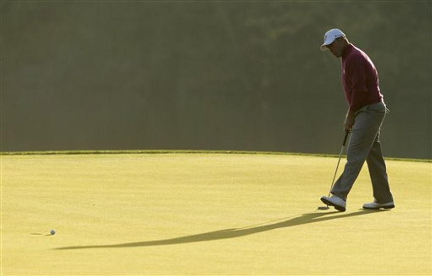 Europe's Lee Westwood watches his putt on the second hole during a foursomes match at the Ryder Cup PGA golf tournament Saturday, Sept. 29, 2012, at the Medinah Country Club in Medinah, Ill. (AP Photo/Charlie Riedel)